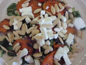 photo of Warm sweet potato salad, with feta cheese, spinach, rocket, beans and tomatoes