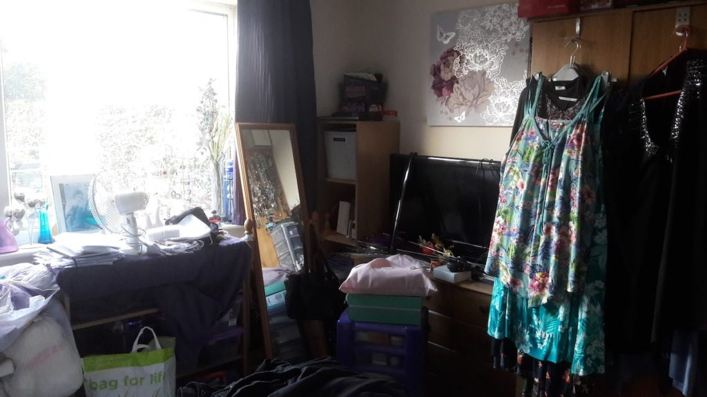 photo of a messy, cluttered bedroom