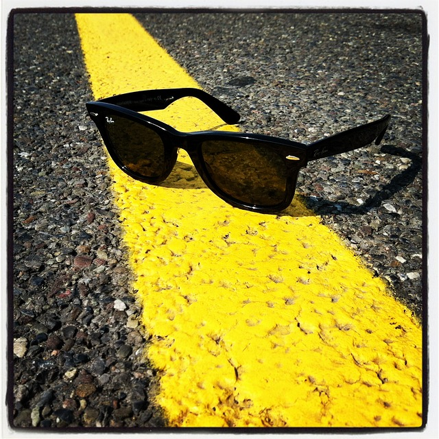 yellow line on a road with sunglasses. Image by Ryan McGuire