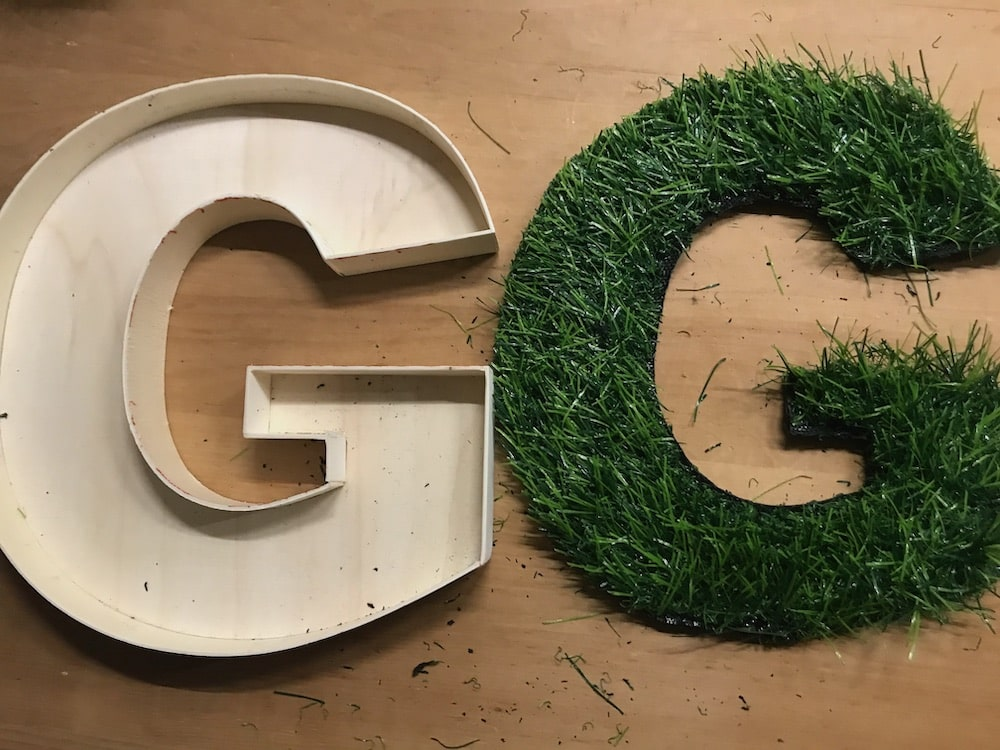 The letter G in fake grass
