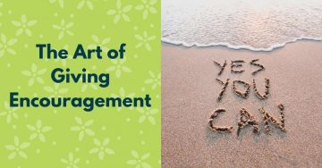 the art of giving encouragement - 'yes you can' written in the sand